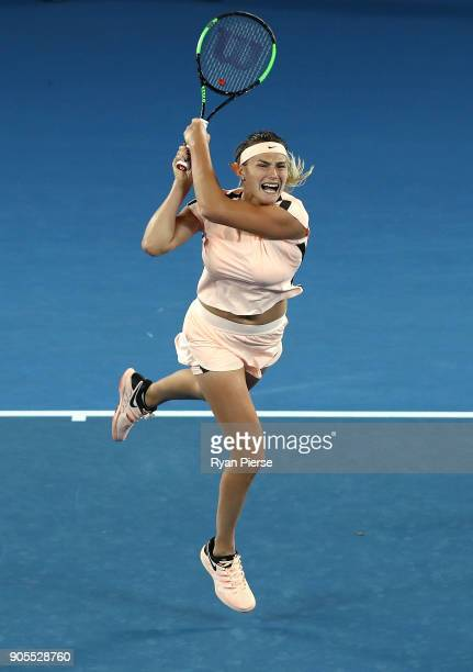Aryna Sabalenka of Belarus plays a backhand during her first round match against Ashleigh Barty of Australia on day two of the 2018 Australian Open...