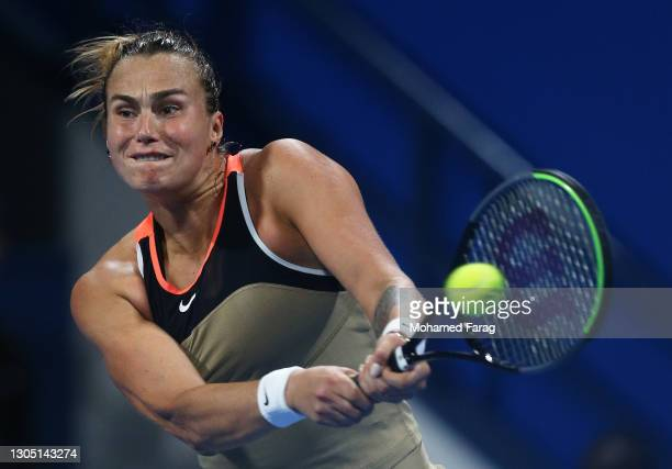 Aryna Sabalenka of Belarus plays a backhand in her Round of 16 singles match against Garbine Muguruza of Spain during Day Three of the Qatar Total...