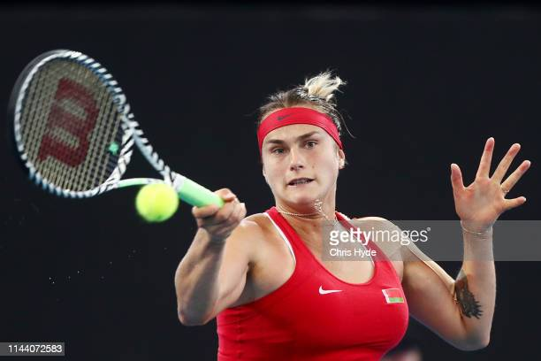 Aryna Sabalenka of Belarus plays a forehand in her match against Ashleigh Barty of Australia during the Fed Cup World Group Semi Final Australia v...
