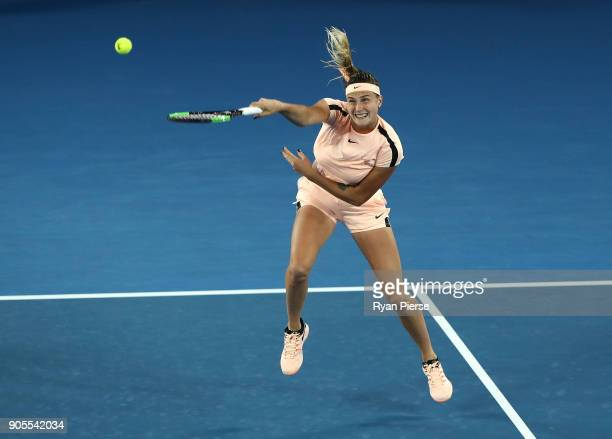 Aryna Sabalenka of Belarus plays a smash during her first round match against Ashleigh Barty of Australia on day two of the 2018 Australian Open at...