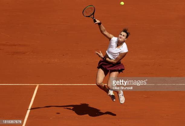 Aryna Sabalenka of Belarus plays a smash in her first round match against Vera Zvonareva during day two of the Mutua Madrid Open Tennis at La Caja...