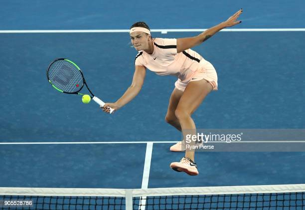 Aryna Sabalenka of Belarus plays a volley during her first round match against Ashleigh Barty of Australia on day two of the 2018 Australian Open at...