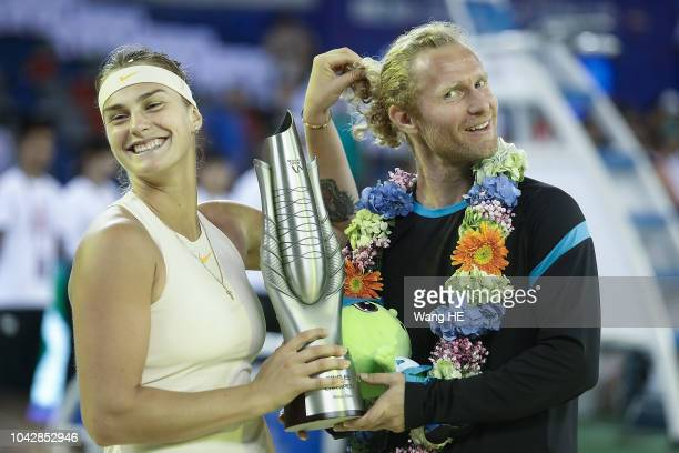 Aryna Sabalenka of Belarus poses for photo with her coach Dmitry Tursunov during victory ceremony after winning the singles final against Anett...