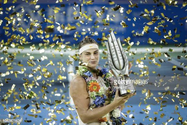 Aryna Sabalenka of Belarus poses with her trophy after defeating Anett Kontaveit of Estonia during 2018 Wuhan Open singles final match at Optics...