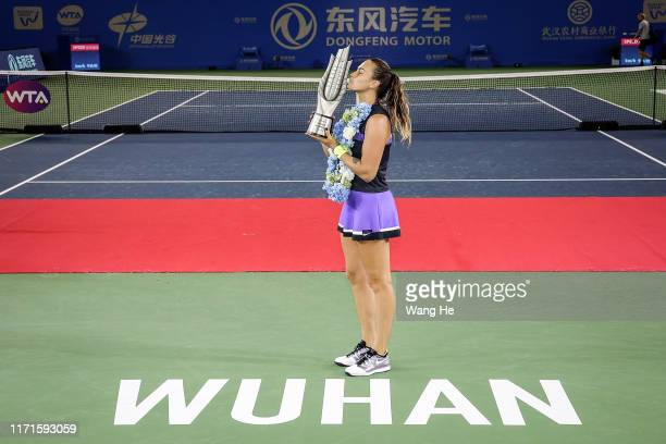 Aryna Sabalenka of Belarus poses with her trophy after defeating Alison Riske of USA during 2019 Wuhan Open singles final match at Optics Valley...