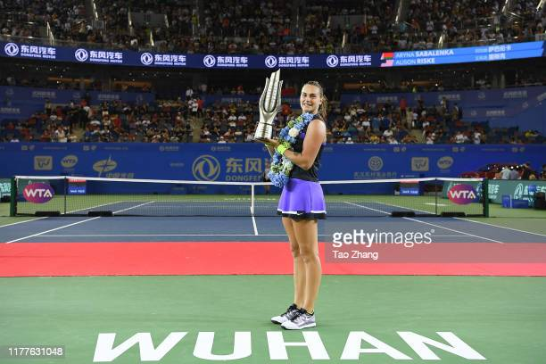 Aryna Sabalenka of Belarus poses with her trophy after defeating Alison Riske of the United States during 2019 Wuhan Open singles final match at...