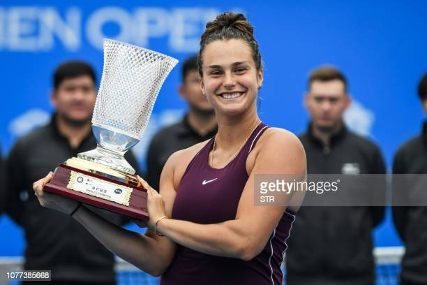 Aryna Sabalenka of Belarus poses with her trophy after winning the women's singles final match against Alison Riske of the US during the Shenzhen...