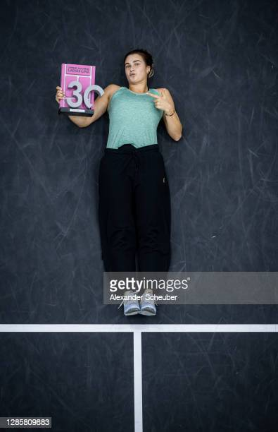 Aryna Sabalenka of Belarus poses with the trophy during the finals of the Upper Austria Ladies Linz at TipsArena on November 15 2020 in Linz Austria