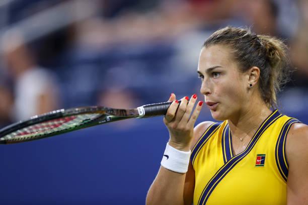 Aryna Sabalenka of Belarus reacts against Elise Mertens of Belgium during her Women's Singles round of 16 match on Day Seven at USTA Billie Jean King...