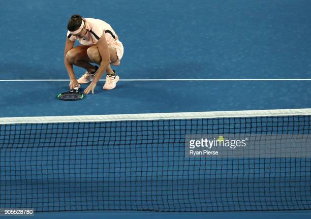 Aryna Sabalenka of Belarus reacts during her first round match against Ashleigh Barty of Australia on day two of the 2018 Australian Open at...