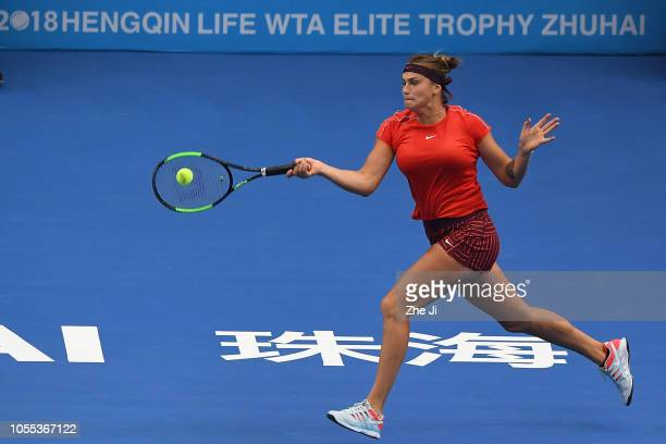 Aryna Sabalenka of Belarus return a shot against Ashleigh Barty of Australia during the women's singles 1st Round match of the 2018 WTA Elite Trophy...