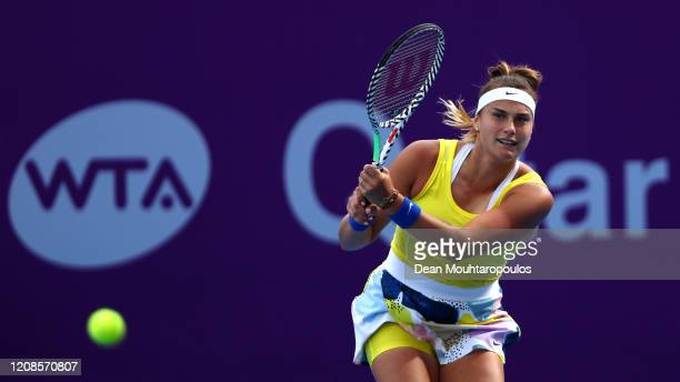 Aryna Sabalenka of Belarus returns a backhand against Anett Kontaveit of Estonia during Day 3 of the WTA Qatar Total Open 2020 at Khalifa...