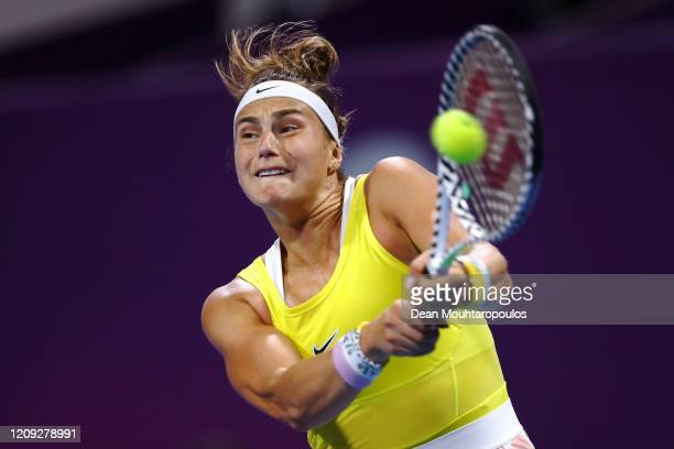 Aryna Sabalenka of Belarus returns a backhand against Svetlana Kuznetsova of Russia in their semi final match during Day 6 of the WTA Qatar Total...