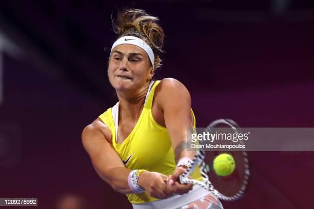 Aryna Sabalenka of Belarus returns a backhand against Svetlana Kuznetsova of Russia in their semi final match during Day 6 of the WTA Qatar Total...