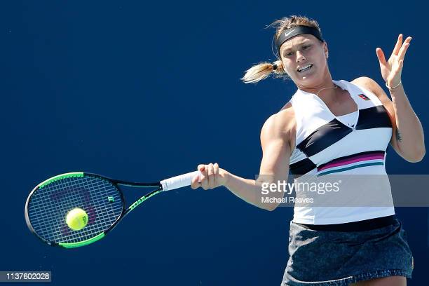 Aryna Sabalenka of Belarus returns a shot against Ajla Tomljanovic of Australia during Day 5 of the Miami Open Presented by Itau at Hard Rock Stadium...