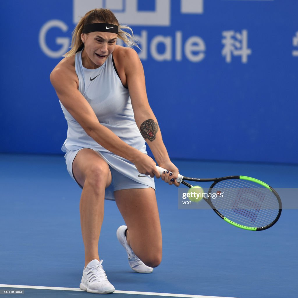 Uncategorized Simona Suh belarus aryna sabalenka falls down during the fed cup world group of returns a shot quarterfinal match against simona halep romania