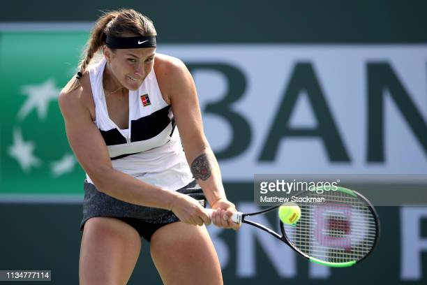 Aryna Sabalenka of Belarus returns a shot to Ajla Tomljanovic of Australia during the BNP Paribas Open at the Indian Wells Tennis Garden on March 09...