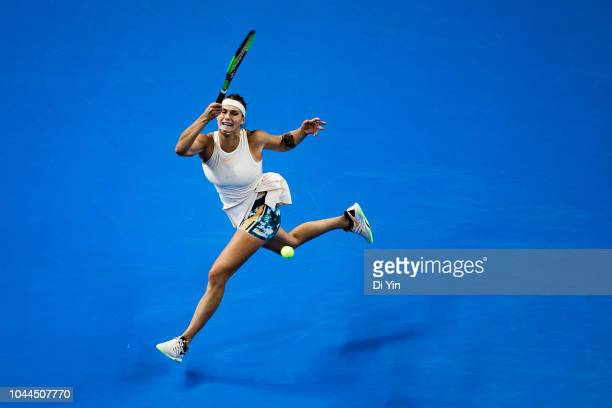Aryna Sabalenka of Belarus returns the ball against Garbine Muguruza of Spain during her Women's Singles Second Round match of the 2018 China Open at...