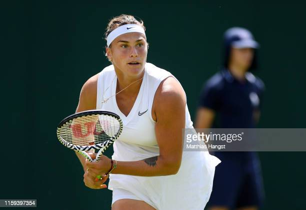 Aryna Sabalenka of Belarus runs to play a shot in her Ladies' Singles first round match against Magdalena Rybarikova of Slovakia during Day one of...