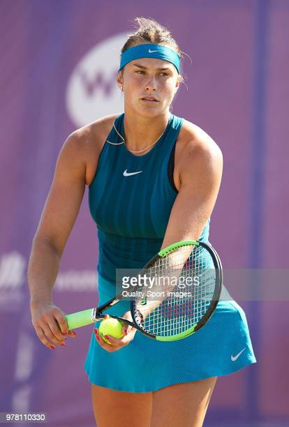 Aryna Sabalenka of Belarus serves during her match against Alison Van Uytvanck of Belgium during day one of the Mallorca Open at Country Club Santa...