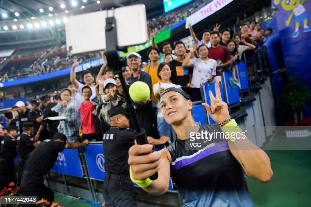 Aryna Sabalenka of Belarus takes a selfie with fans after winning the semifinal match against Ashleigh Barty of Australia on Day six of 2019 Dongfeng...