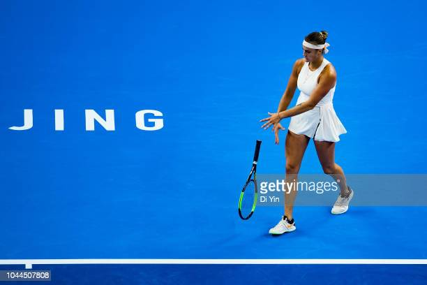 Aryna Sabalenka of Belarus throws her racquet during her Women's Singles Second Round match with Garbine Muguruza of Spain of the 2018 China Open at...