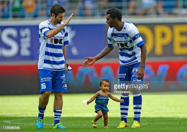 Arzo Amposta Cesar of KAA Gent shakes hands after the victory with Renato Neto of KAA Gent with his daughter after the Jupiler League match between...