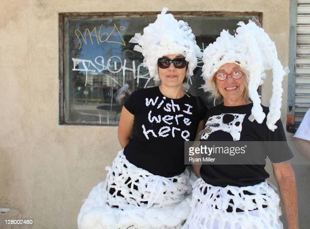 Arzu Ardakosar and Beth Elliott pose during the Trespass Parade through downtown Los Angeles and ending at the Museum of Contemporary Art to...