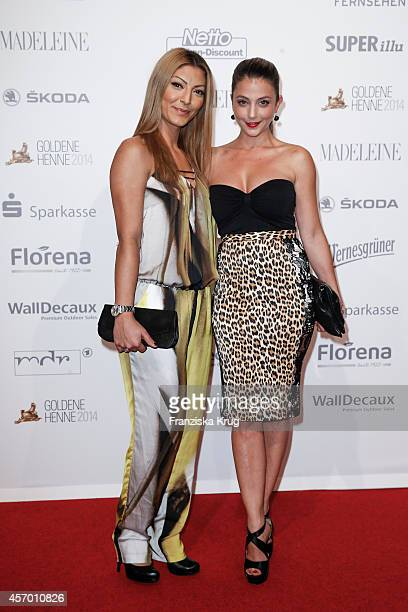 Arzu Bazman and guest attend Madeleine at Goldene Henne 2014 on October 10 2014 in Leipzig Germany