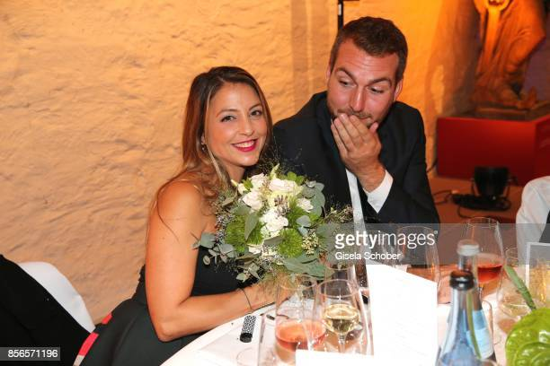 Arzu Bazman and her boyfriend Simon Guse after she caught the bride bouquet during the church wedding of Erdogan Atalay and Katja Ohneck at...