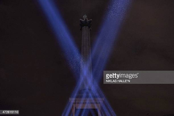 As 70 years ago floodlights light up the sky around Nelson's Column in Trafalgar Square in central London on May 8 to commemorate the 70th...