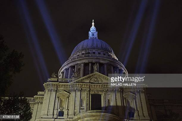 As 70 years ago floodlights light up the sky around St Paul's Cathedral in central London on May 8 to commemorate the 70th anniversary of the end of...