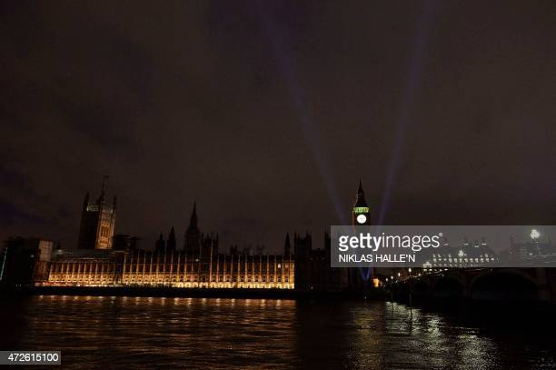 As 70 years ago floodlights light up the sky around the landmark Elizabeth Tower more commonly known as Big Ben beside the Houses of Parliament in...