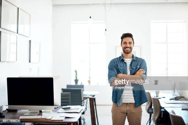 as a creative thinker, i'm always driving innovation forward - man in office stock photos and pictures