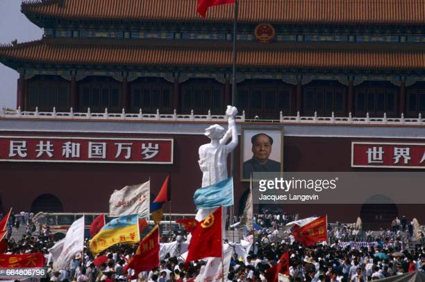 As a final act of protest at the end of their unsuccessful hunger strike students erect a statue called the Goddess of Democracy opposite Tian'an Men...