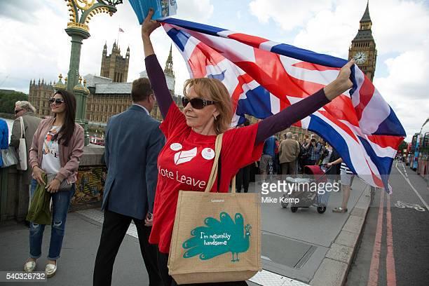 As a flotilla of fishing vessels on the River Thames arrive outside the Houses of Parliament protesters gather to cheer them on as part of the Vote...