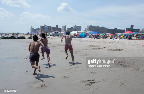 As a heat wave descends upon New York people seek refuge from the record high temperatures at the beach in Coney Island on July 20 2019 in New York...