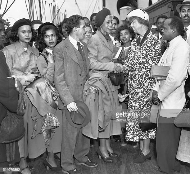 As a Howard University Trustee Eleanor Roosevelt bids farewell to 21 African American students and three faculty members of Howard University before...