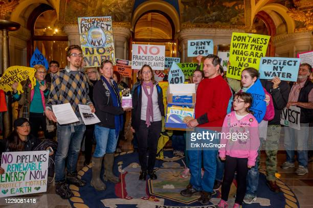 As a key waterquality certificate permit deadline looms New Yorkers rally outside and inside the New York State Capitol building in Albany to urge...