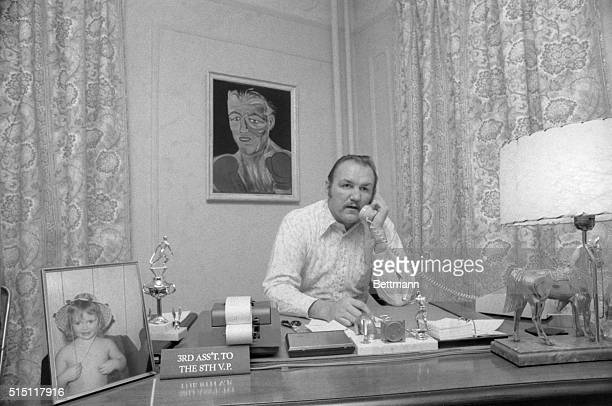 As a liquor salesman, Chuck Wepner, has to do his share of desk work and phone calling. A sign, a picture of his daughter and a portrait of him in...