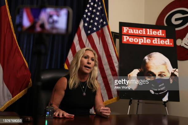 As a poster of director of the U.S. National Institute of Allergy and Infectious Diseases Anthony Fauci is seen in the background, U.S. Rep. Marjorie...
