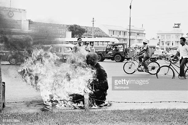 As a protest against the Ngo Dinh Diem government's antiBuddhist policies a young Buddhist monk performs a ritual suicide by self immolation in the...