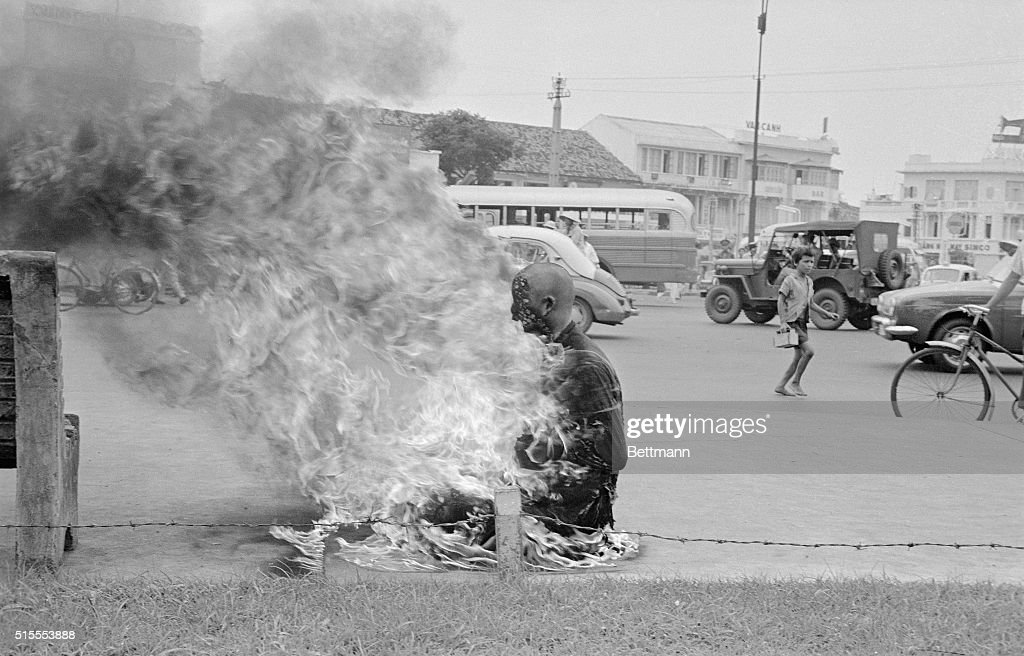 As a protest against the Ngo Dinh Diem government's anti-Buddhist policies, a young Buddhist monk performs a ritual suicide, by self immolation, in the central market square of Saigon.
