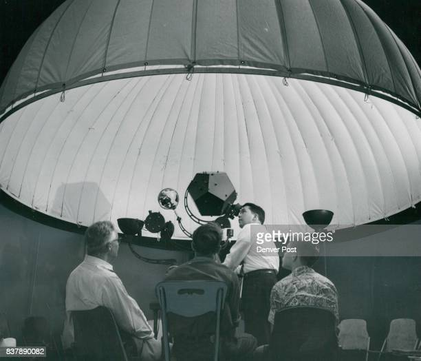 As a reward for helping him set up his 'canvas sky' in Chamberlin observatory Herbert Williams of the Spitz Laboratories gives three members of the...