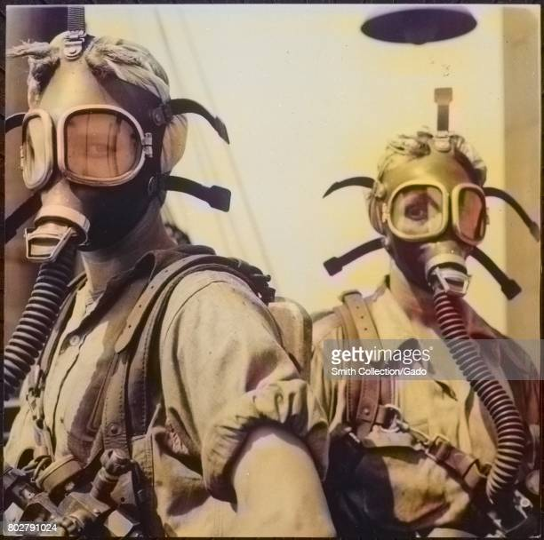 As a safety measure women wear oxygen masks when they clean around the tops of blast furnaces at US Steel's Gary Indiana 1945 Image courtesy National...