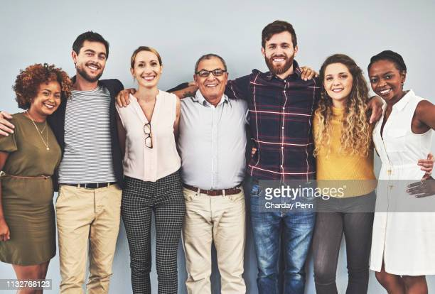 as a team, nothing can defeat us - gruppo di persone foto e immagini stock