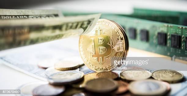 As a visual representation of the digital Cryptocurrency Bitcoin with US Dollar Euro Coins on November 9 2017 in Hong Kong Hong Kong Cryptocurrencies...