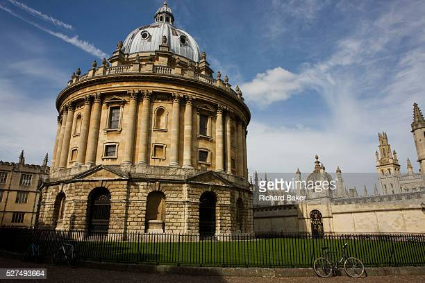 As a wide general view we see the famous Oxford landmark the Radcliffe Camera without people but with a solitary modern bicycle chained to railings...