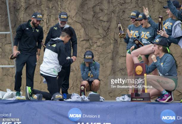 As Adams State accepts the championship trophy at the Division II Women's Cross Country Championship held at the Angel Mounds on November 18 2017 in...