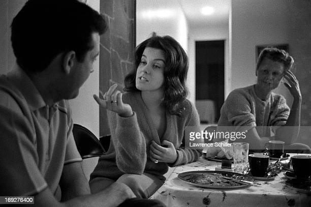 As an unidentified woman watches Swedishborn American actress AnnMargret speaks with agent Jack Gilardi in her home Los Angeles California 1963